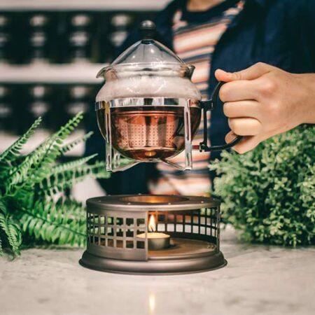 GROSCHE nairobi teapot and food dish warmer placing teaapot on tealight candle