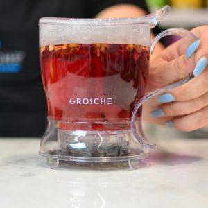 Grosche-Aberdeen-GR-317-on-counter-top-empty-smart-tea-maker-tea-infuser-with-red-loose-tea