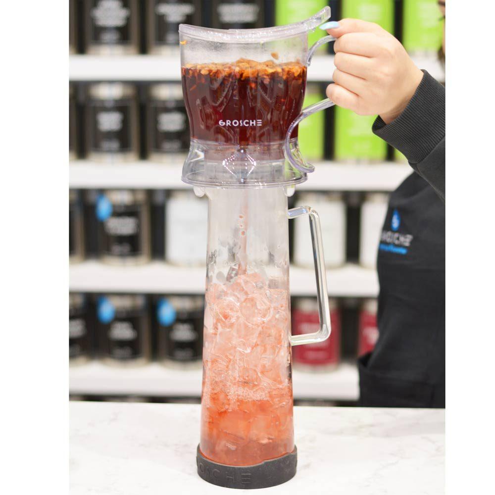 Grosche Aberdeen smart tea maker pouring red tea into Bali water pitcher