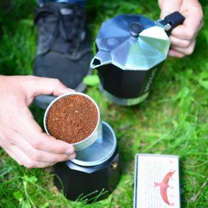 Adding-fine-ground-coffee-to-Grosche-Milano-Stovetop-camping-espresso-coffee-maker