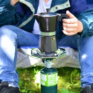 Camping-coffee-making-espresso-grosche-Milano-stovetop-espresso-maker-on-flame-300x300