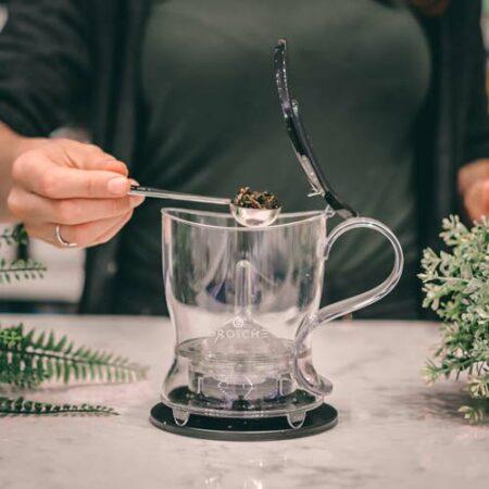 GROSCHE aberdeen loose leaf tea maker adding tea to teapot