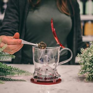 GROSCHE aberdeen red loose leaf tea maker adding tea to teapot