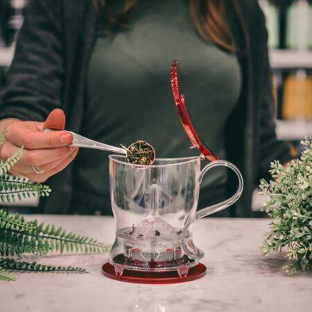 GROSCHE aberdeen red loose leaf tea maker adding tea to teapot