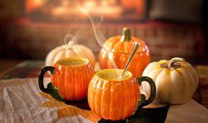 pumpkin spice lattes in pumpkin mugs